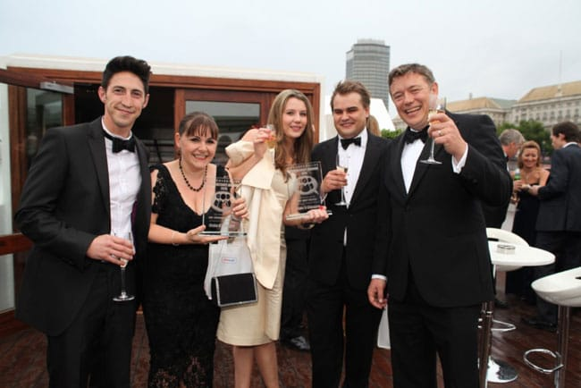 The Make It Cheaper team celebrate winning two awards at TELCA 2013